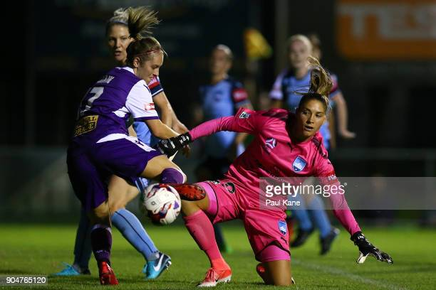 Marianna Tabain of the Perth Glory looks for a goal against Aubrey Bledsoe of Sydney during the round 11 WLeague match between the Perth Glory and...