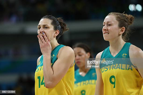 Marianna Tolo of Australia and Natalie Burton leave the court dejected following the Women's Quarterfinal match between Australia and Serbia at the...
