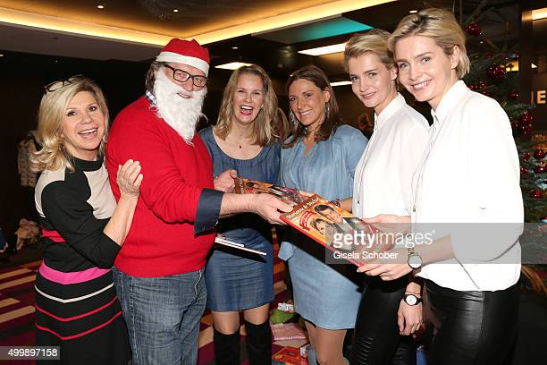 Marianne and Michael Hartl, Monica Ivancan, Simone Ballack, Julia Meise and her twin sister Nina Meise during the World Childhood Foundation Baking...