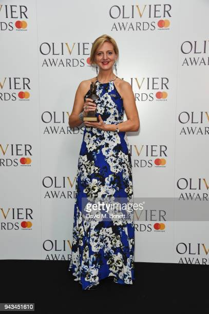 Marianne Elliott accepting the Best Revival award for 'Angels In America' poses in the press room during The Olivier Awards with Mastercard at Royal...
