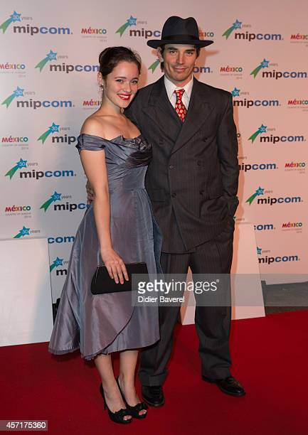 Marianne Fortier and Sebastien Delorme attend the opening red carpet party MIPCOM 2014 at Hotel Martinez on October 13 2014 in Cannes France