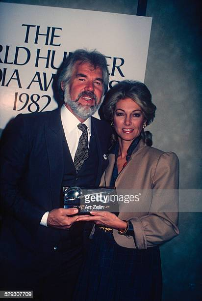 Marianne Gordon Rogers with her husband Kenny Rogers with The World Hunger Media Award 1980