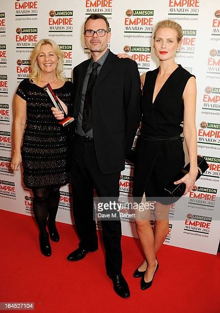 Marianne Gray Asle Vatn and Synnove Macody Lund pose in the press room with the Best Thriller award for 'Headhunters' at the Jameson Empire Awards...