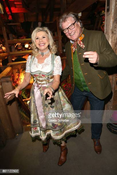 Marianne Hartl and her husband Michael Hartl dance during the Oktoberfest at Theresienwiese on September 21 2017 in Munich Germany