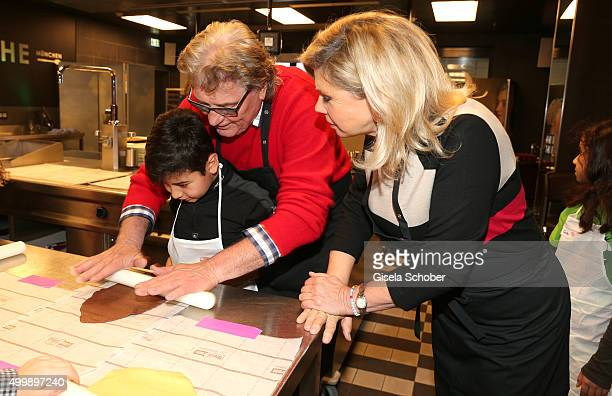 Marianne Hartl and her husband Michael Hartl prepare cookies with a boy during the World Childhood Foundation Baking at Hotel Vier Jahreszeiten on...
