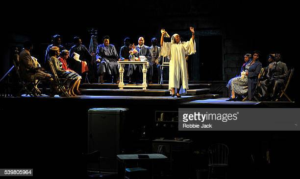 Marianne JeanBaptiste as Margaret Alexander with artists of the company in James Baldwin's The Amen Corner directed by Rufus Norris at the National...