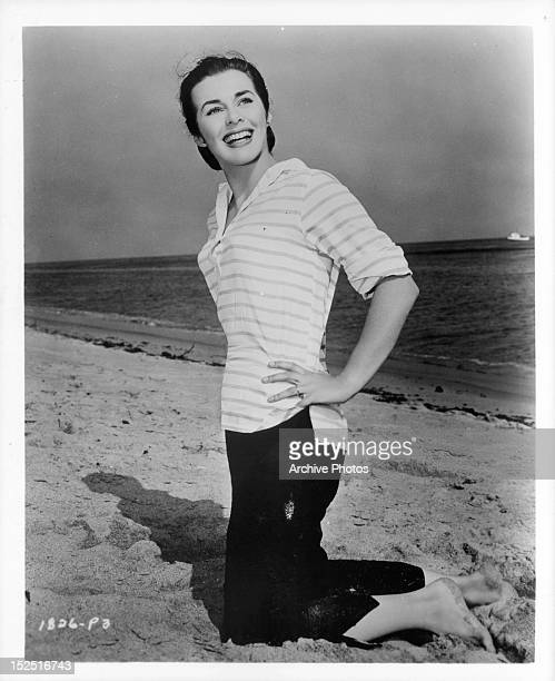 Marianne Koch smiling on the beach in publicity portrait the film 'Four Girls In Town', 1957.