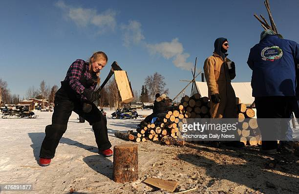 Marianne Mallory chops firewood at the Nikolai checkpoint during the 2014 Iditarod Trail Sled Dog Race on Wednesday March 5 in Alaska
