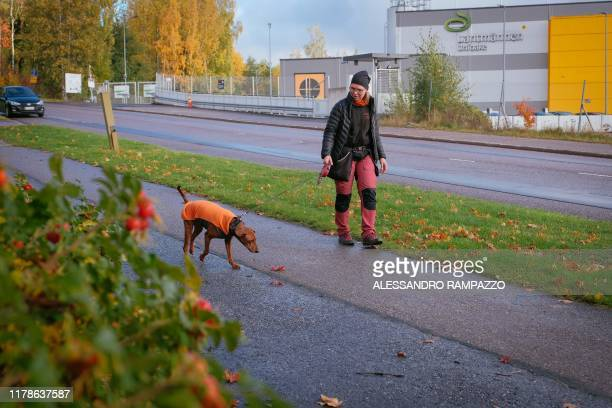 Marianne Mayer dog trainer and promoter of a campaign that aims to give dog poo a new life takes a walk with one of her dogs in Vantaa Finland on...