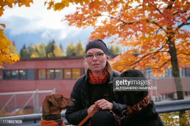 Marianne Mayer dog trainer and promoter of a campaign that aims to give dog poo a new life poses for a picture together with her dogs in Vantaa...