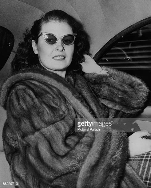 Marianne O'Brien Reynolds former actress and wife of Richard J Reynolds heir to the RJ Reynolds Tobacco Company leaves Idlewild Airport New York on...