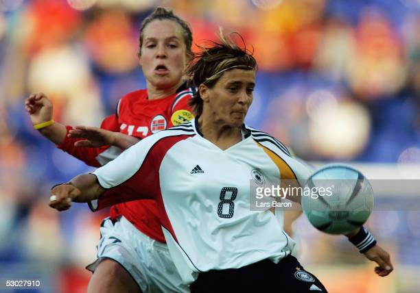Marianne Paulsen from Norway in action with Sandra Smisek from Germany during the UEFA Women's Championship group B preliminary match between Germany...