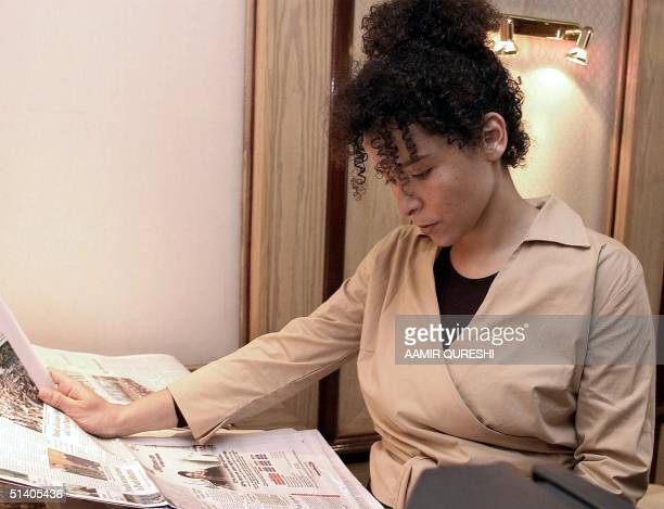 Marianne Pearl reads newspaper inside her hotel room in Karachi, 06 February 2002, as she awaits the release of her husband, Daniel Pearl, a...