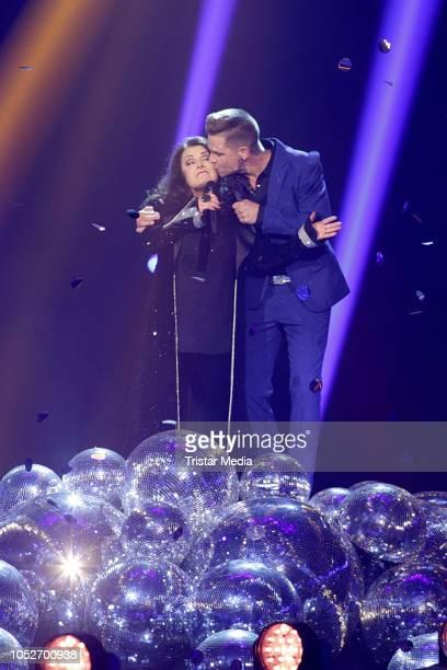 Marianne Rosenberg and Eloy de Jong perform during the tv show 'Schlagerbooom 2018 Alles funkelt Alles glitzert' at Westfalen Stadium on October 20...