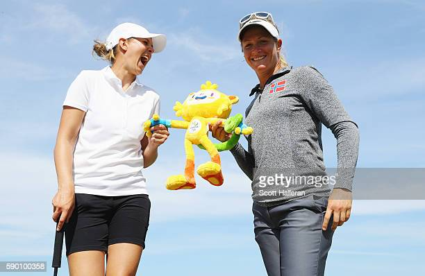 Marianne Skarpnord and Suzann Pettersen of Norway pose together during a practice round prior to the start of the women's golf during Day 11 of the...