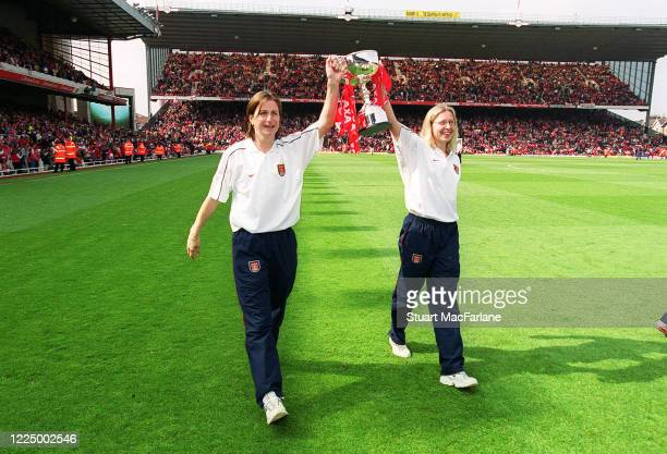 Marianne Spacey and Jayne Ludlow of Arsenal Women parade the Womens League Championship Trophy during half time of the Premier League match between...