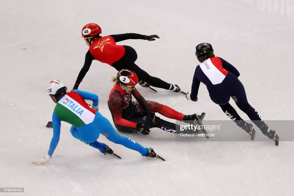 Marianne St Gelais of Canada falls as Martina Valcepina of Italy, Yutong Han of China and Veronique Pierron of France skate past during the Short Track Speed Skating Ladies' 1500m Semifinals on day eight of the PyeongChang 2018 Winter Olympic Games at Gangneung Ice Arena on February 17, 2018 in Gangneung, South Korea.