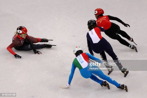 Marianne St Gelais of Canada falls as Martina Valcepina of Italy Yutong Han of China and Veronique Pierron of France skate past during the Short...