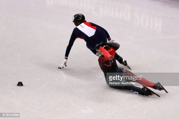 Marianne St Gelais of Canada falls as Veronique Pierron of France skates past during the Short Track Speed Skating Ladies' 1500m Semifinals on day...