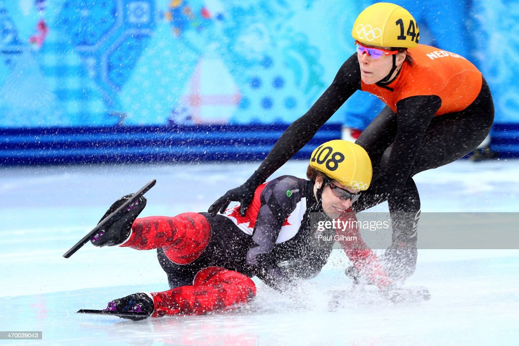 Marianne St. Gelais of Canada falls while competing in the Short Track Ladies' 1000m Heat at Iceberg Skating Palace on day 11 of the 2014 Sochi Winter Olympics on February 18, 2014 in Sochi, Russia.