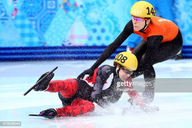 Marianne St Gelais of Canada falls while competing in the Short Track Ladies' 1000m Heat at Iceberg Skating Palace on day 11 of the 2014 Sochi Winter...
