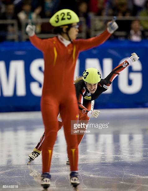 Marianne StGelais of Canada smiles during her second place finish as Meng Wang of China finishes first in the ladies 500m final at the ISU World Cup...