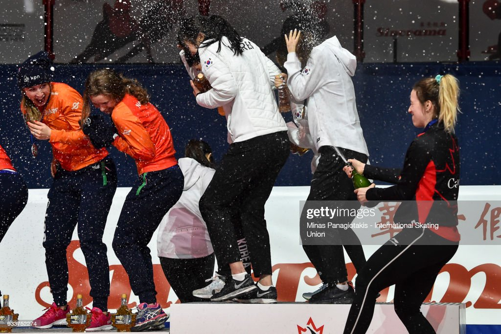 Marianne St-Gelais of Canada sprays champagne after Team Canada wins the bronze in the women's 3000 meter relay Final during the World Short Track Speed Skating Championships at Maurice Richard Arena on March 18, 2018 in Montreal, Quebec, Canada.