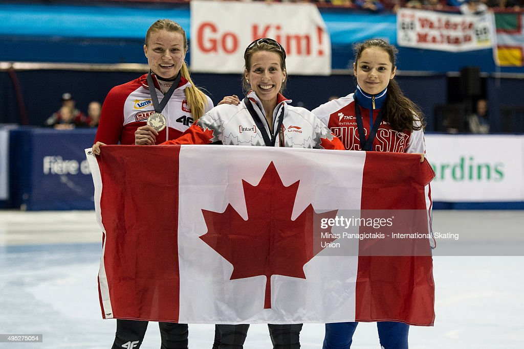 Marianne St-Gelais of Canada (centre) wins gold, Natalia Maliszewska of Poland (left) silver and Sofia Prosvirnova of Russia (right) wins bronze in the women's 500 meter final on Day 2 of the ISU World Cup Short Track Speed Skating competition at Maurice-Richard Arena on November 1, 2015 in Montreal, Quebec, Canada.