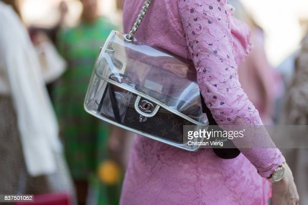Marianne Theodorsen wearing a pink dress boots with floral print and transparent Chanel bag outside byTiMo on August 22 2017 in Oslo Norway