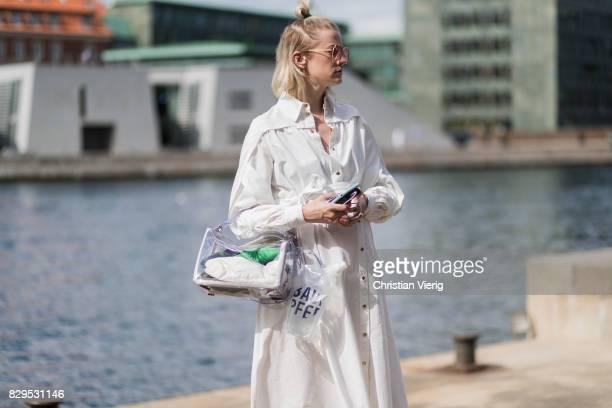 Marianne Theodorsen wearing a sheer Loewe bag white coat outside Designers Remix on August 10 2017 in Copenhagen Denmark