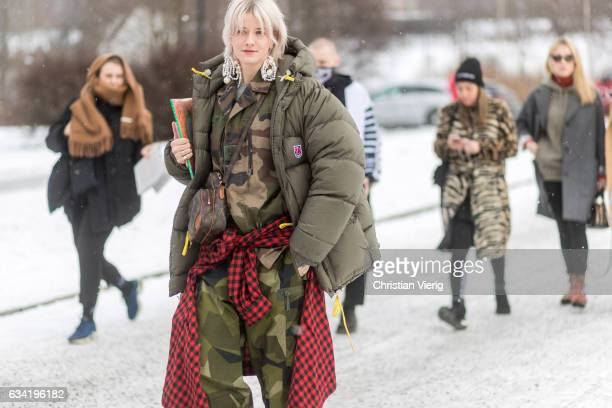 Marianne Theodorsen wearing an olive down feather jacket camouflage pants and jacket on February 7 2017 in Oslo Norway