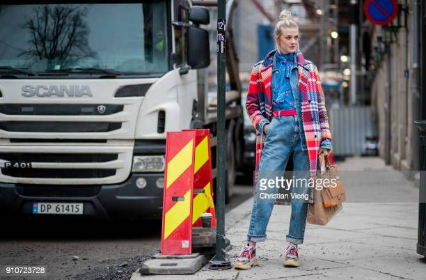 Marianne Theodorsen wearing checked coat cropped denim jeans Acne bag Chanel bag Balenciaga sneakers is seen outside by TiMo on January 26 2018 in...