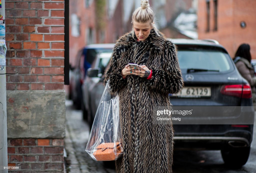 Marianne Theodorsen wearing fur coat, Chanel bag, Balenciaga sneaker is seen outside IBEN on January 26, 2018 in Oslo, Norway.