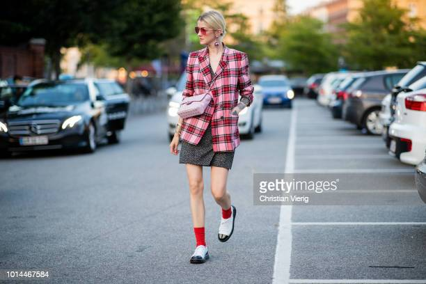 Marianne Theodorsen wearing pink checked jacket pink Chanel bag dress is seen outside Saks Potts during the Copenhagen Fashion Week Spring/Summer...