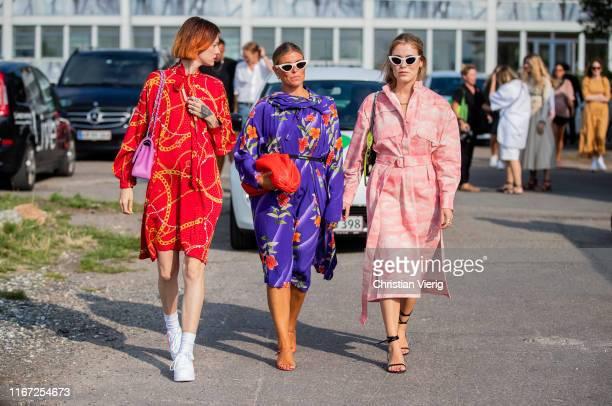 Marianne Theodorsen wearing red dress, pink Chanel bag, Janka Polliani wearing purple dress and Annabel Rosendahl wearing pink belted suit is seen...