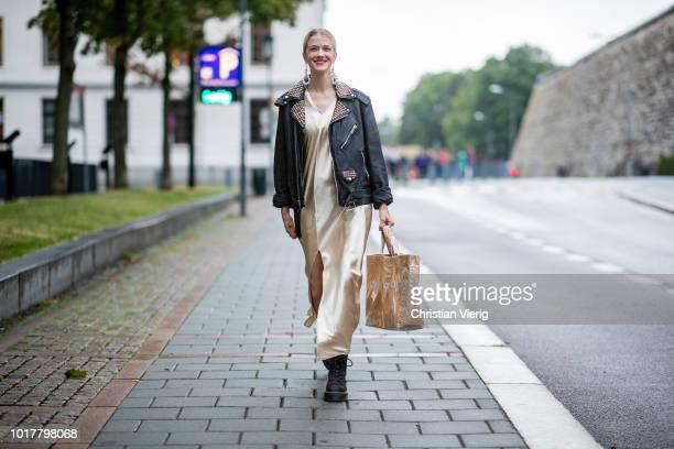 Marianne Theodorsen wearing silk dress leather jacket seen outside Bik Bok Runway Award during Oslo Runway SS19 on August 16 2018 in Oslo Norway