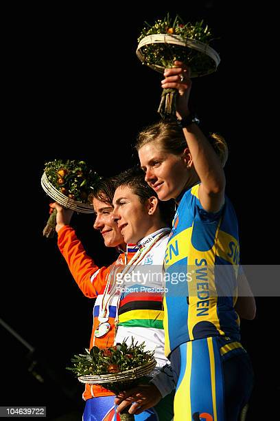 Marianne Vos of the Netherlands Giorgia Bronzini of Italy and Emma Johansson of Sweden celebrate after the Women's Elite Road Race on day four of the...