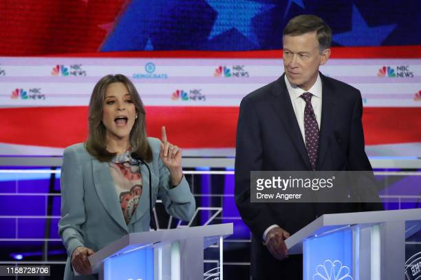 Marianne Williamson speaks as former Colorado governor John Hickenlooper looks on during the second night of the first Democratic presidential debate...