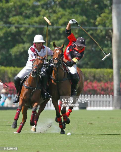 Mariano Agurerre of Postage Stamp plays the ball in front of Gonzalo Pieres of Pilot during the 2019 Captive One U.S. Open Polo Championship on April...