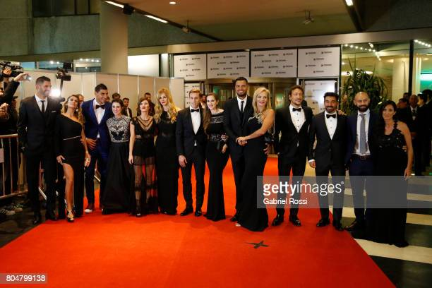 Mariano Andujar Nahuel Guzman Lucas Biglia Sergio Romero Ezequiel Lavezzi and Javier Mascherano pose for pictures on the red carpet along with...