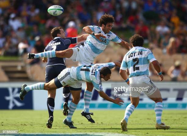 Mariano Baud of Argentina and Lewis Calder of Scotland compete for the ball during the match between Scotland and Argentina during day two of the IRB...