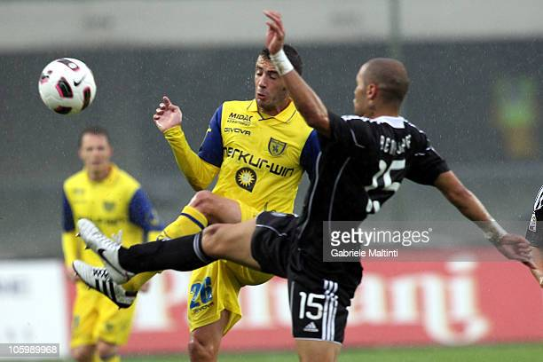 Mariano Bogliacino of AC Chievo Verona battles for the ball with Benalouane Yoan of AC Cesena during the Serie A match between AC Chievo Verona and...
