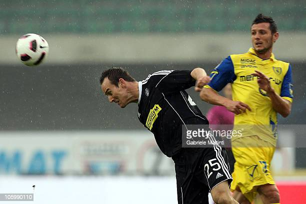 Mariano Bogliacino of AC Chievo Verona battles for the ball with Steve Van Berger of AC Cesena during the Serie A match between AC Chievo Verona and...
