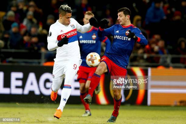 Mariano Díaz of Olympique Lyonnais in action against Alan Dzagoev of CSKA Moscow during the UEFA Europa League round of 16 first leg soccer match...
