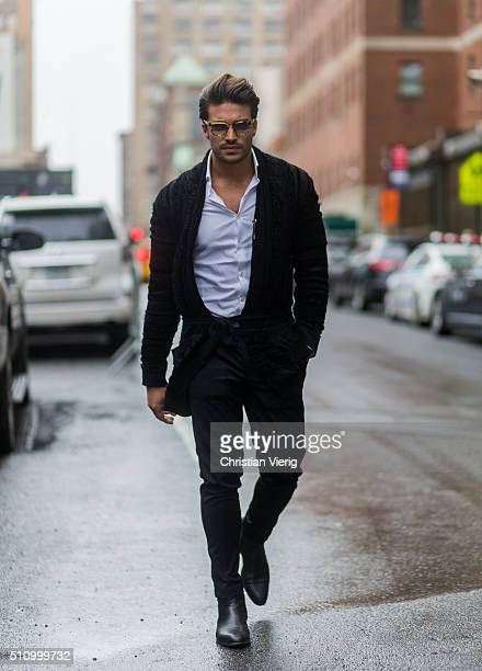 Mariano di Vaio wearing a black wool cardigan seen outside Vera Wang during New York Fashion Week Women's Fall/Winter 2016 on February 16 2016 in New...