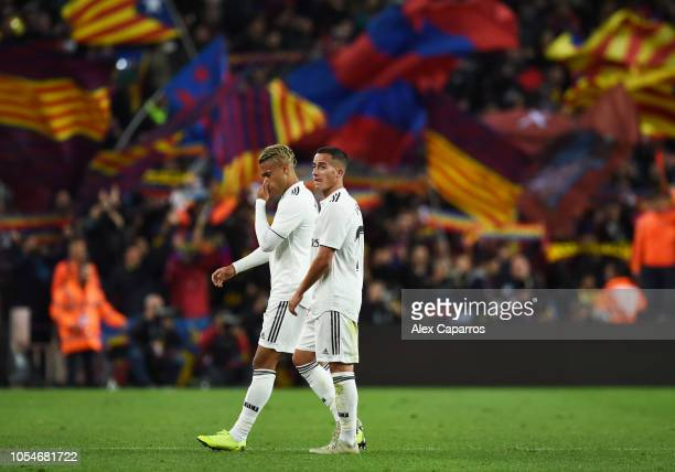 Mariano Diaz and Lucas Vazquez of Real Madrid look dejected in defeat after the La Liga match between FC Barcelona and Real Madrid CF at Camp Nou on...