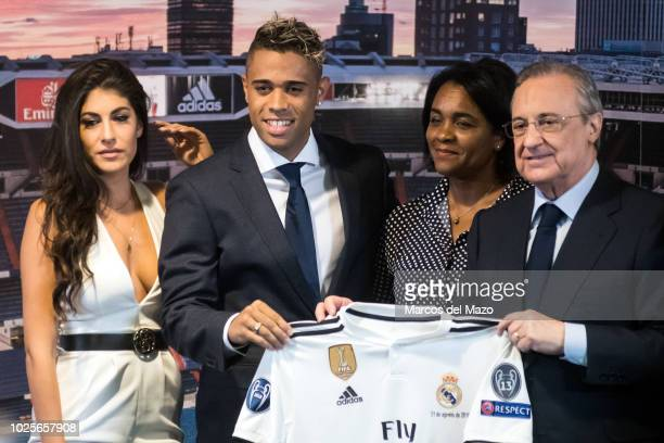 Mariano Diaz Mejia and his girlfriend Yaiza Moreno Real Madrid President Florentino Perez posing for the press during the presentation as a new...