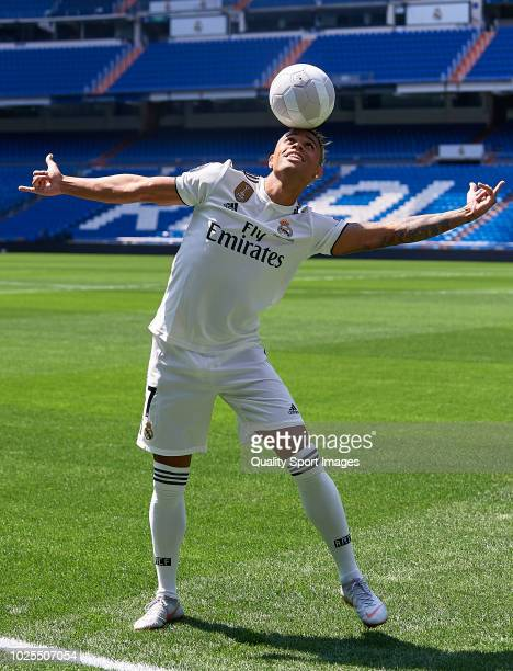 Mariano Diaz Mejia plays with a ball on the pitch after being announced as a Real Madrid player at Santiago Bernabeu Stadium on August 31 2018 in...