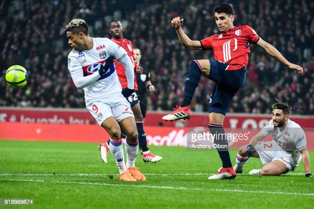 Mariano Diaz of Lyon and Junior Alonso of Lille during the Ligue 1 match between Lille OSC and Olympique Lyonnais at Stade Pierre Mauroy on February...
