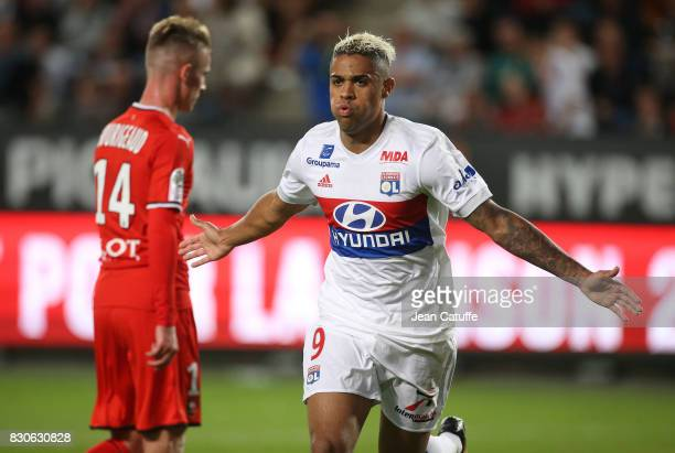 Mariano Diaz of Lyon celebrates his goal while Benjamin Bourigeaud of Stade Rennais looks down during the French Ligue 1 match between Stade Rennais...